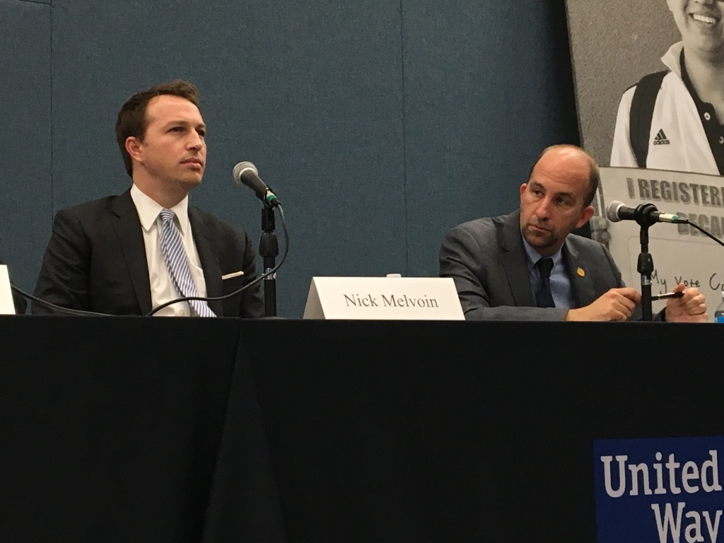 L.A. Unified School Board candidate Nick Melvoin, left, and incumbent board president Steve Zimmer listen during a recent candidate forum.