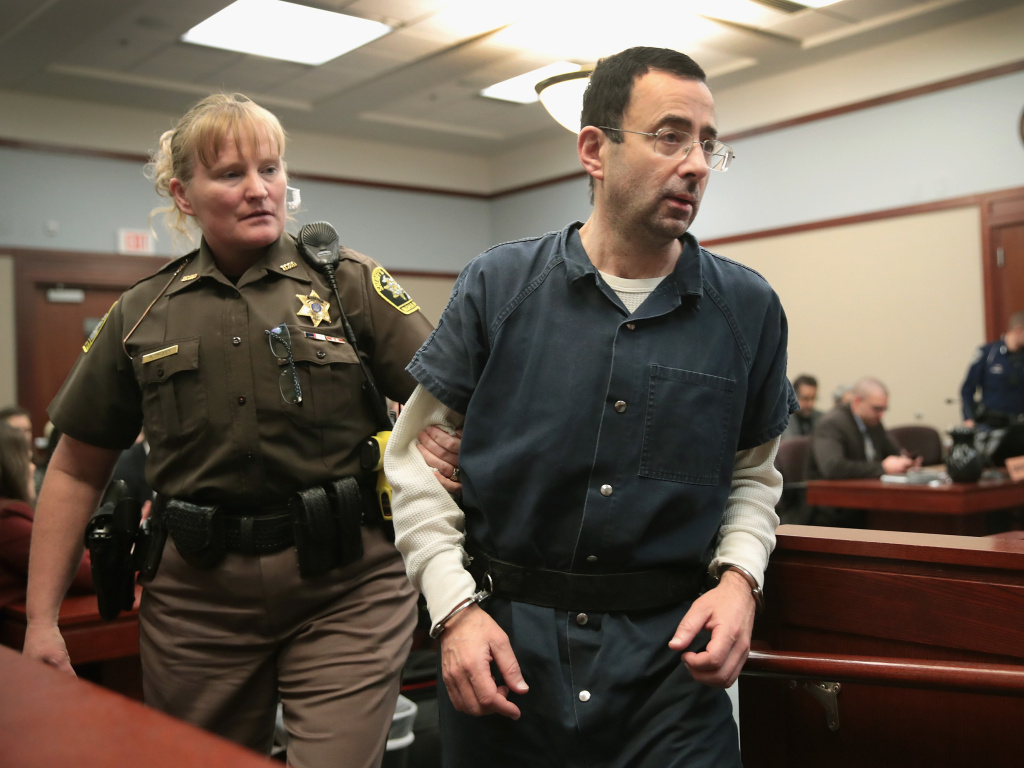 Larry Nassar appears in court last Wednesday in Lansing, Mich., to listen to victim impact statements during his sentencing hearing. He was accused of molesting more than 100 girls while he was a physician for USA Gymnastics and Michigan State University.