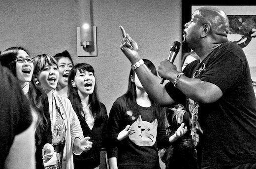 Pastor Richard Hartley leads his students in the Tokyo Mass Choir during rehearsal