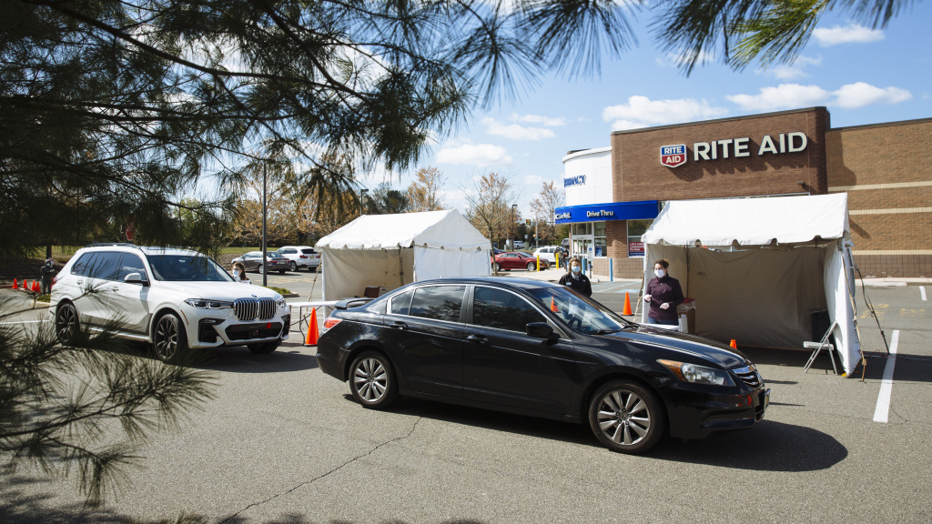 People in cars arrive at a drive-up COVID-19 testing site outside a Rite Aid in Toms River, New Jersey, on April 22. About 3 percent of Rite Aid stores are offering testing for the virus.