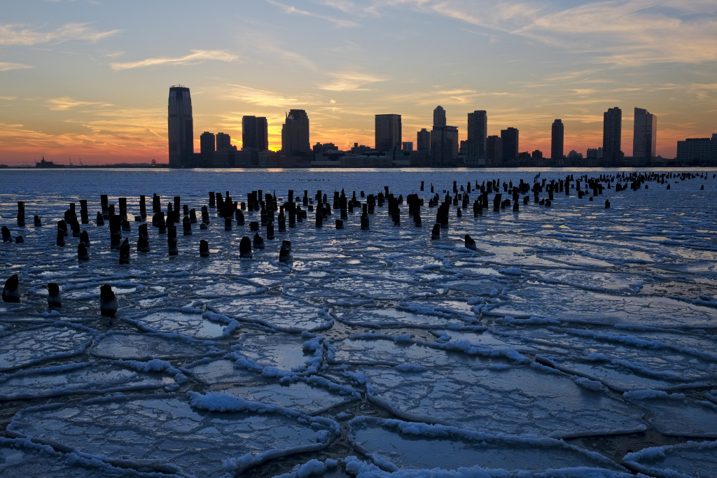 Ice floes fill the Hudson River as the New Jersey waterfront is seen during sunset on January 9, 2014 in New York City. A recent cold spell, caused by a polar vortex descending from the Arctic, caused the floes to form in the Hudson.