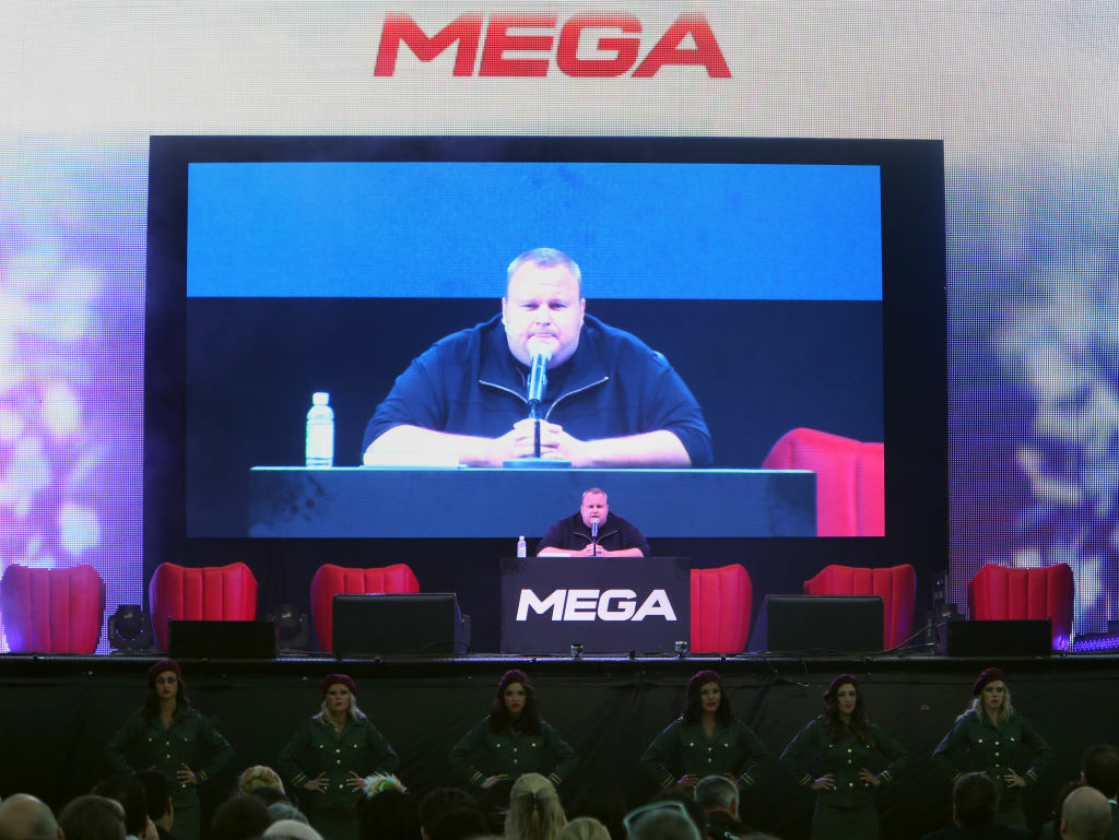Megaupload founder Kim Dotcom speaks during the launch of his new website at a press conference at his mansion in Auckland on January 20, 2013.
