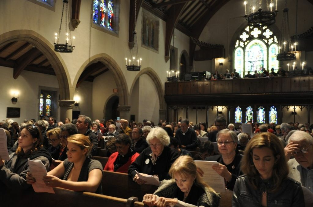 Worshippers at All Saints Church in Pasadena, Calif. take in a Sunday sermon addressing the massacre of 20 elementary school children and six school staffers by a gunman in Newton, Conn. last Friday. The Rev. Ed Bacon consoled mourners, but also called for political action against gun violence and the firearms lobby. Dec. 16, 2012
