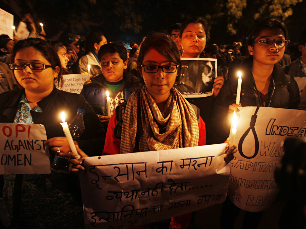 Participants in a candlelight vigil in 2013 mark the one-year anniversary of the death of a 23-year-old woman who was gang-raped on a bus in Delhi.