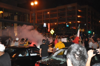 Laker fans start a fire in the intersection of 9th and Hope in Downtown Los Angeles after a Laker victory in Game 7 of the NBA Finals on June 17, 2010