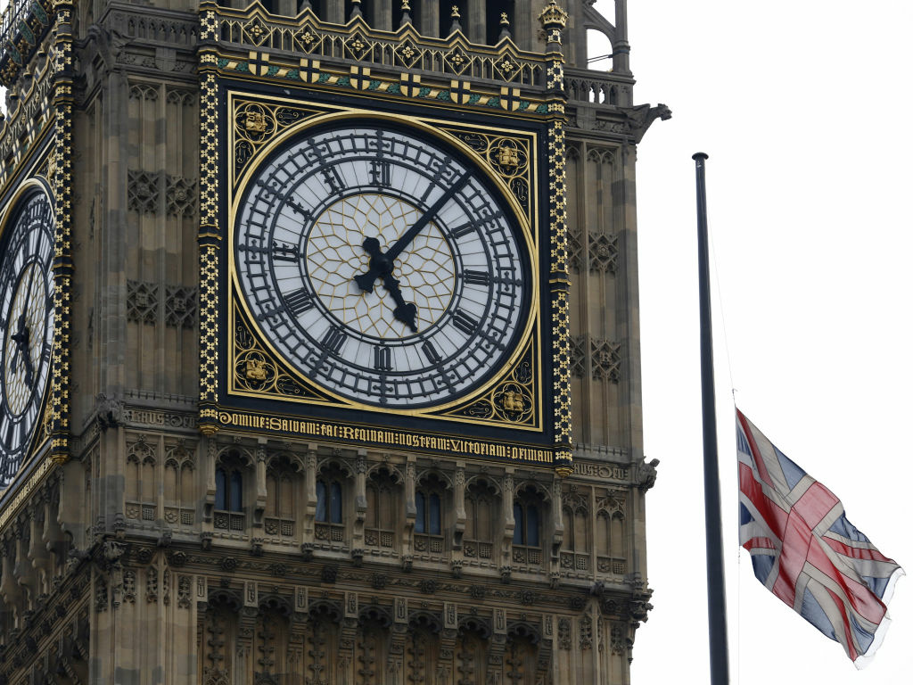 A Union flag flies at half staff over the Houses of Parliament, and next to the Big Ben clock tower, in honor of former Prime Minister Margaret Thatcher, who died Monday.
