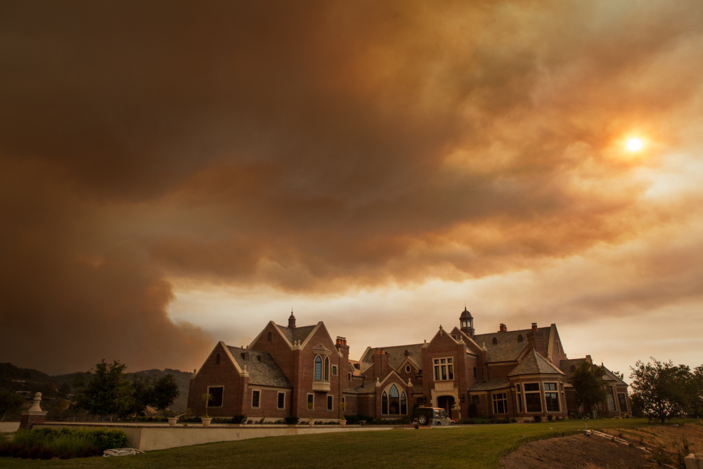 Smoke billows over a home in the Hidden Valley region of Ventura County during the Springs Fire on May 3rd, 2013.