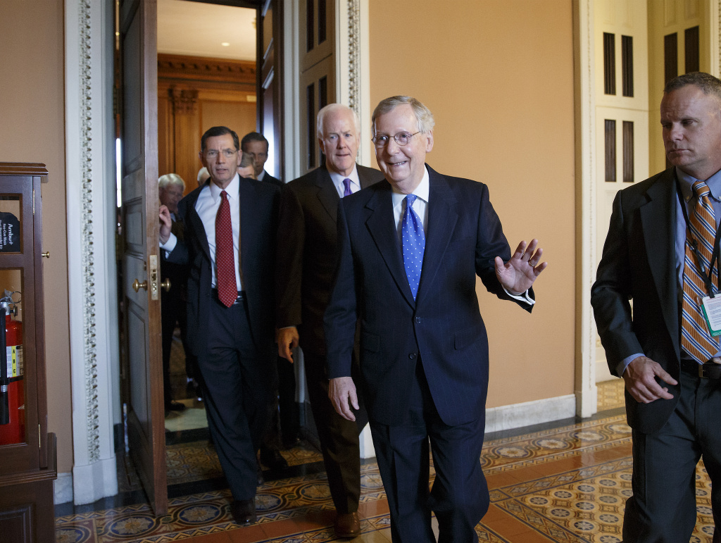 Senate Minority leader Mitch McConnell of Ky. emerges from a closed-door meeting on Capitol Hill in Washington, Thursday, Nov. 13, 2014, where he was chosen by acclamation to be the new Senate majority leader when the new Congress convenes in January. He is followed by Senate Minority Whip John Cornyn of Texas, and Sen. John Barrasso, R-Wyo., Republican Policy Committee chairman, left. As majority leader, one of the most powerful positions in Congress, McConnell will set the Senate's agenda. Along with Republican House Speaker John Boehner, he will decide what legislation is sent to the White House in the final two years of President Barack Obama's term.