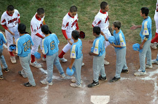 Players from Japan and the United States Little League teams, shake hands after the game on August 29, 2010 in South Willamsport, Pennsylvania.
