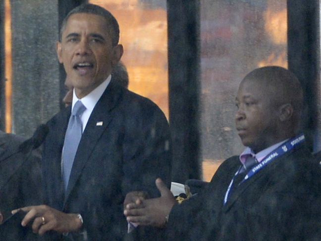 As President Obama and other world leaders spoke Monday in Johannesburg at a memorial for Nelson Mandela, a man stood nearby and appeared to be doing sign language interpretation. Many in the deaf community are outraged because the man appeared to be faki