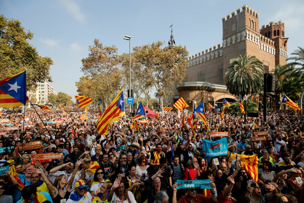 People holding Esteladas (Pro-independence Catalan flag) gather outside the Catalan parliament in Barcelona on October 27, 2017.