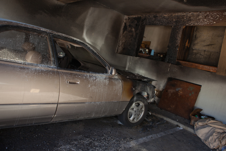Firefighters respond to a fire at an apartment complex in Sherman Oaks that spread to several cars early Monday morning.