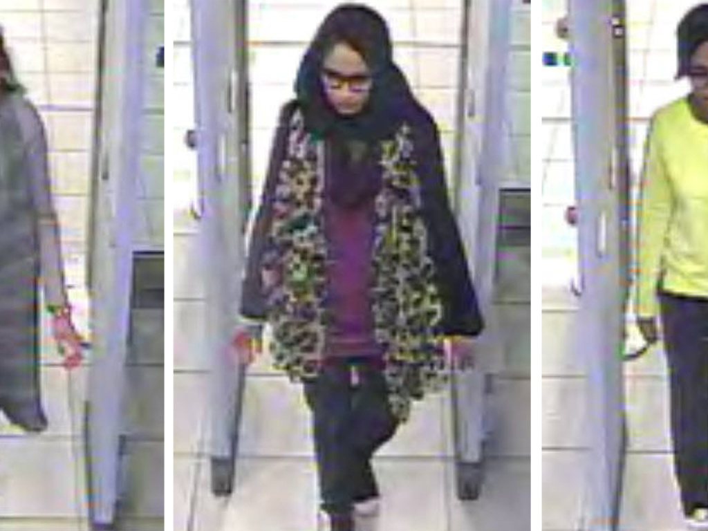 CCTV images issued by the Metropolitan Police in London in 2015, show Shamima Begum, center, and her friends walking through security at Gatwick airport, on their way to Syria.