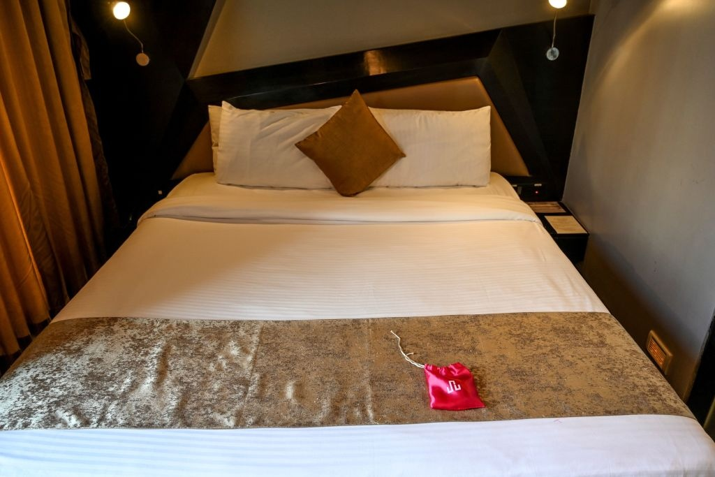 In this photo taken on February 10, 2020 a 'love kit' is seen on the bed in a room at the Dragonfly hotel in Mumbai.