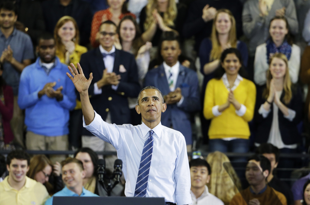 President Barack Obama waves as he exits the stage after speaking at Georgia Tech about his plan to clamp down on the private companies that service federal student debt, Tuesday, March 10, 2015, in Atlanta. More than 40 million Americans are in debt thanks to their education, and most of their loans come from Uncle Sam. So President Barack Obama is aiming to clamp down on the private companies that service federal student debt with a presidential memorandum he signed Tuesday.