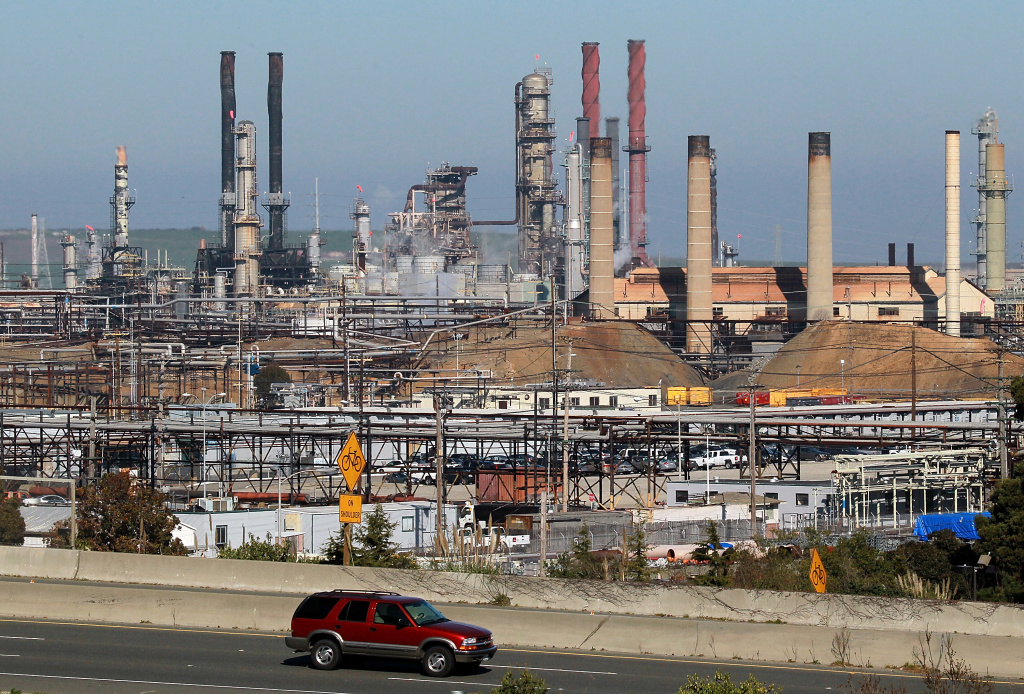 A car drives past the Chevron refinery on January 25, 2011 in Richmond, California.