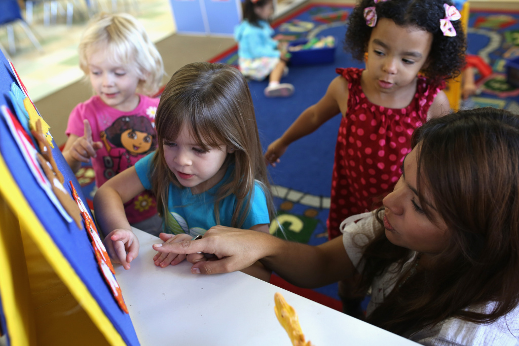 Children at Scripps Ranch KinderCare in San Diego play in their classroom with teacher LuAnn Cline who was surprised with the Early Childhood Educator Award and a $10,000 check from Knowledge Universe.