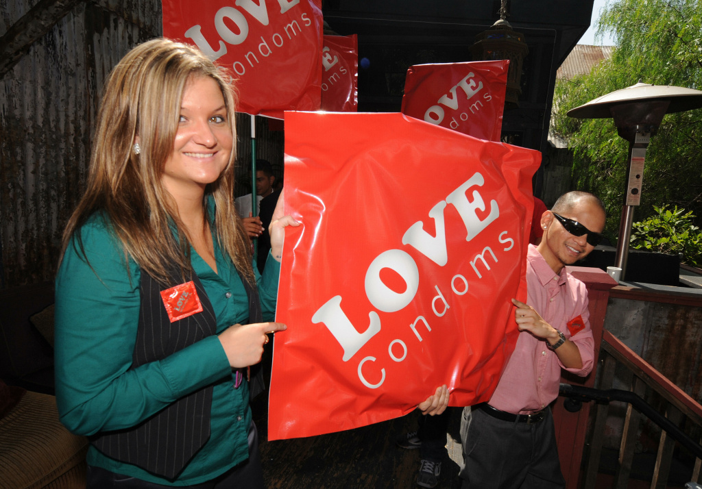 AIDS activists carry large condom packets during the launch of the