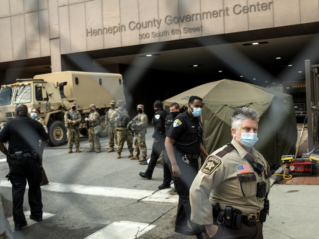 The Hennepin County Government Center, where former police officer Derek Chauvin is being tried on murder charges, is surrounded by security fencing and is guarded against possible violence. Jurors are escorted into the building by sheriff's deputies. Here, members of the Minnesota National Guard and other agencies stand watch outside the building in Minneapolis.