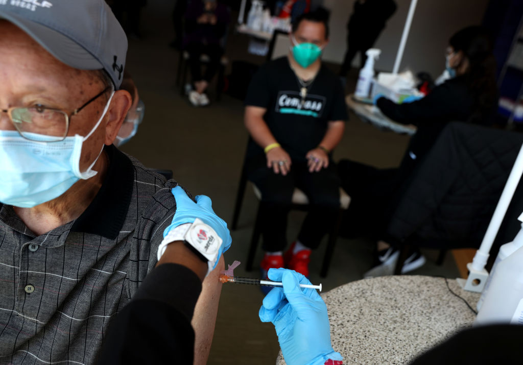 Robert Leong gets a COVID-19 vaccination with his son Ryan, a Special Olympics athlete, during a vaccination clinic for Special Olympics athletes, coaches and family members at Levi's Stadium on April 08, 2021 in Santa Clara, California.
