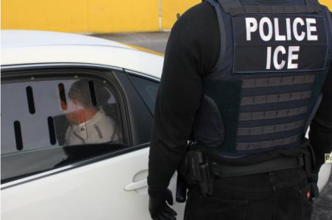 FILE: A U.S. Immigration and Customs Enforcement (ICE) agent makes an arrest in Los Angeles. ICE officials said recent reported arrests of Cambodian immigrants in California and elsewhere are part of an ongoing effort by the U.S. to repatriate Cambodian nationals with deportation orders.