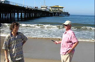 Cal State LA meteorologist Steve LaDochy (L) and JPL climatologist Bill Patzert take readings at the Santa Monica Pier, as part of their Off-Ramp TemperaTour.