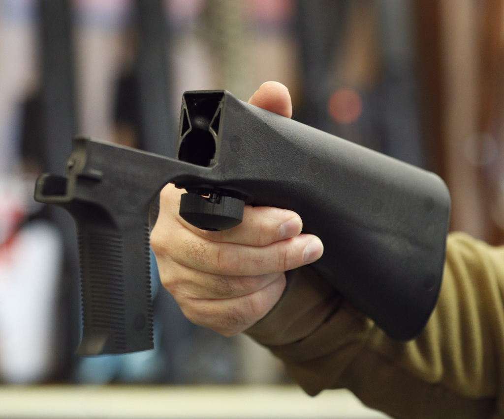 File: A bump stock device that fits on a semi-automatic rifle to increase the firing speed, making it similar to a fully automatic rifle, is shown here at a gun store on October 5, 2017 in Salt Lake City, Utah.