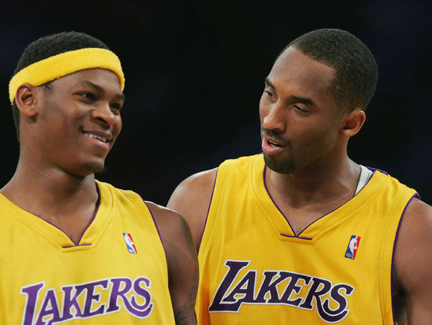 Kobe Bryant #24 talks with his teammate Smush Parker #1 of the Los Angeles Lakers during the game against the New York Knicks on February 13, 2007 at Staples Center in Los Angeles, California.