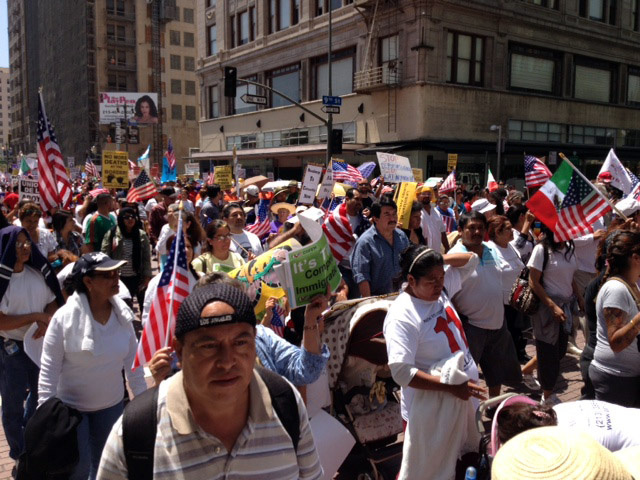 Immigration protesters take to the streets of Los Angeles for a May Day rally march, May 1, 2013.