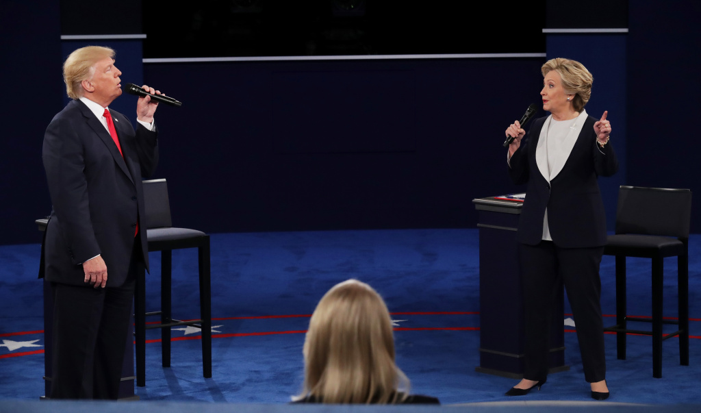 Republican presidential nominee Donald Trump (L) and Democratic presidential nominee former Secretary of State Hillary Clinton speak during the town hall debate at Washington University.