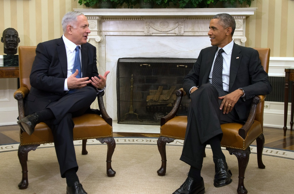 US President Barack Obama (R) speaks with Israeli Prime Minister Benjamin Netanyahu (L) during a bilateral meeting at the White House in Washington, DC, October 1, 2014.