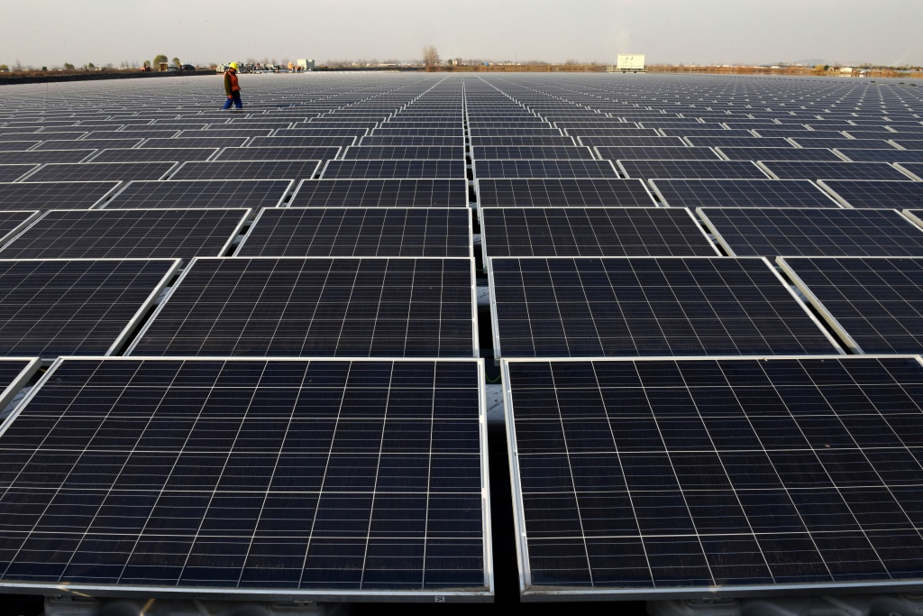 File: This photo taken on Dec. 11, 2017 shows a general view of a floating solar power plant in Huainan, a former coal-mining region, in China's eastern Anhui province.