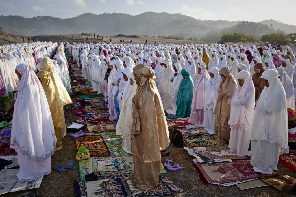 Indonesian muslims perform Eid Al-Adha prayer at Parangkusumo beach on October 15, 2013 in Yogyakarta, Indonesia. Eid Al-Adha, known as the 'Feast of the Sacrifice', is one of the most significant festivals on the Muslim calendar.