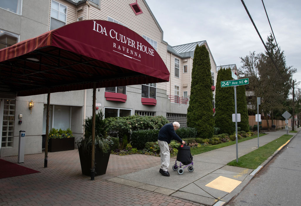 A resident leaves the Ida Culver House retirement community on March 10, 2020 in north Seattle, Washington.