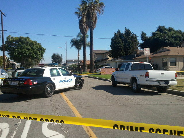 The crime scene at a home in Downey where a shootings that killed three people and injured two took place on Cleta Street, Wednesday, Oct. 24, 2012.