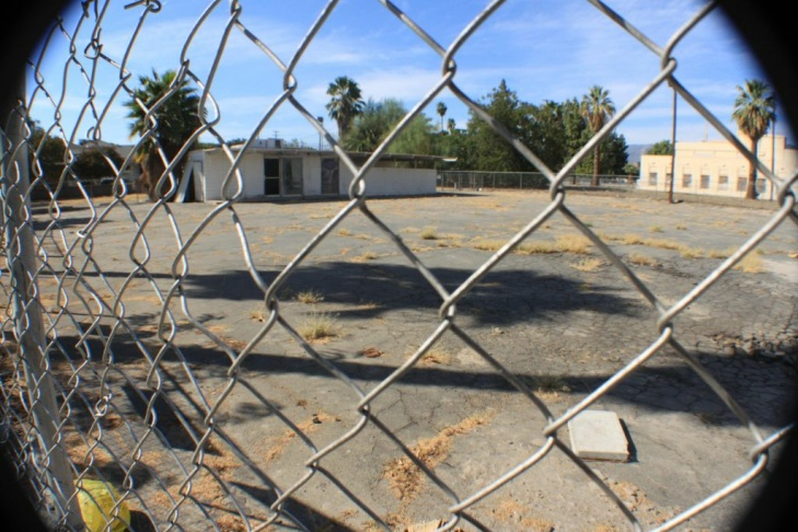"""One of many vacant, distressed properties in downtown San Bernardino. This lot sits right next door to the Greater San Bernardino Area Chamber of Commerce. It's slogan: """"It's  Great Day in San Bernardino"""" defies the city's hard times."""