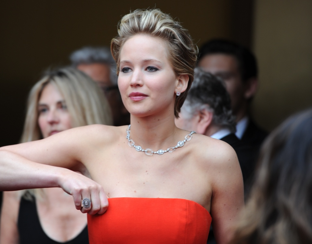 Nominee for Best Supporting Actress in 'American Hustle' Jennifer Lawrence arrives on the red carpet for the 86th Academy Awards on March 2nd, 2014 in Hollywood.