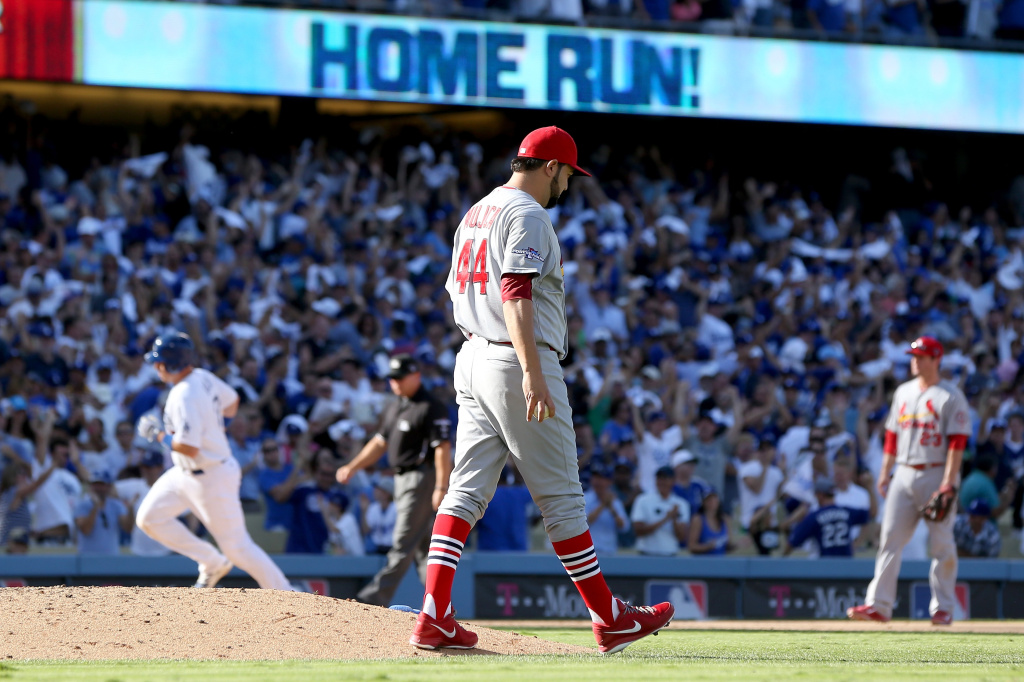 A.J. Ellis #17 of the Los Angeles Dodgers rounds the bases after hitting a solo home off Edward Mujica #44 of the St. Louis Cardinals in the seventh inning in Game Five of the National League Championship Series at Dodger Stadium on Oct. 16, 2013 in Los Angeles.