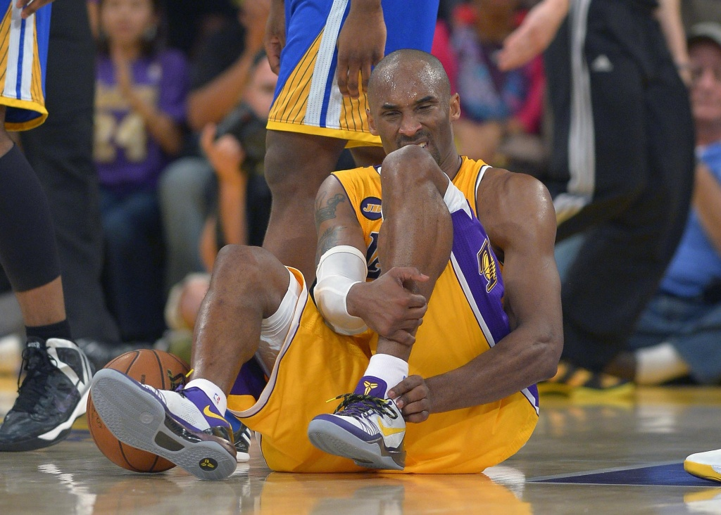 Los Angeles Lakers guard Kobe Bryant grimaces after being injured during the second half of their NBA basketball game against the Golden State Warriors, Friday, April 12, 2013, in Los Angeles. The Lakers won 118-116.