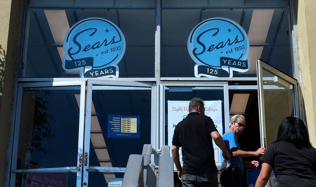 People enter a Sears store in the Boyle Heights neighborhood of Los Angeles, California on October 15, 2018.