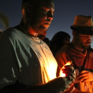 TOPSHOT - Mourners and activists hold a candle light vigil during a rally in El Cajon, a suburb of San Diego, California on September 28, 2016, in protest of the police shooting the night before. Protesters marched in a California town following the fatal police shooting of an unarmed black man said to be mentally ill, as local officials urged calm and pledged a full investigation. The victim, identified as Ugandan refugee Alfred Olango, 30, was shot on Tuesday in the San Diego suburb of El Cajon after police received an emergency call about a man behaving erratically and walking in traffic. / AFP / Bill Wechter        (Photo credit should read BILL WECHTER/AFP/Getty Images)