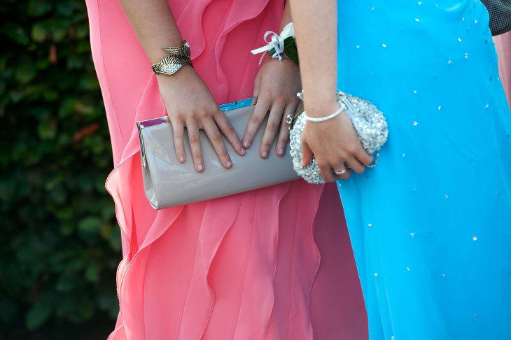 File: Students pose for pictures at a gathering before they travel on a bus to the school prom on July 1, 2011 in Newcastle, United Kingdom.