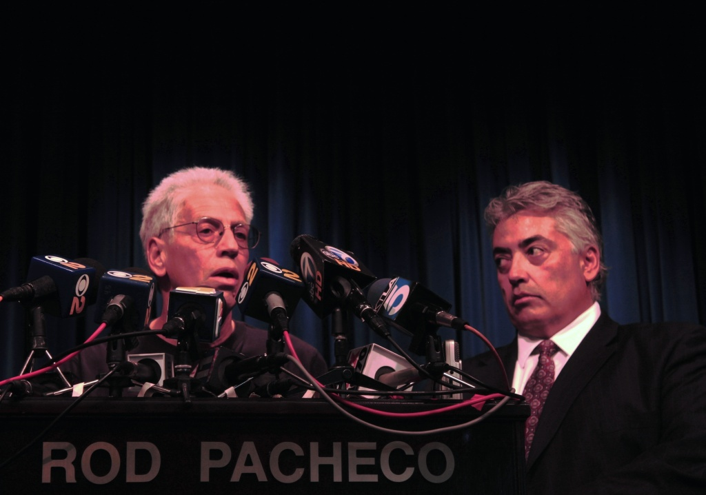 Joseph Bonaminio (left), the father of slain Riverside policeman Ryan Bonaminio, and Riverside County District Attorney Rod Pacheco announce the charges against killer Earl Ellis Green.