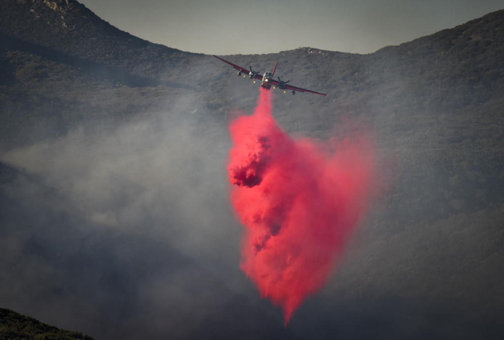 An air tanker drops flame retardant on the Anza Fire Monday afternoon.   The Anza Fire burns in Riverside County, CA in the San Bernardino National Forest near Anza, CA Monday August 10, 2015. By evening the fire had burned 500 acres and was 10% contained.