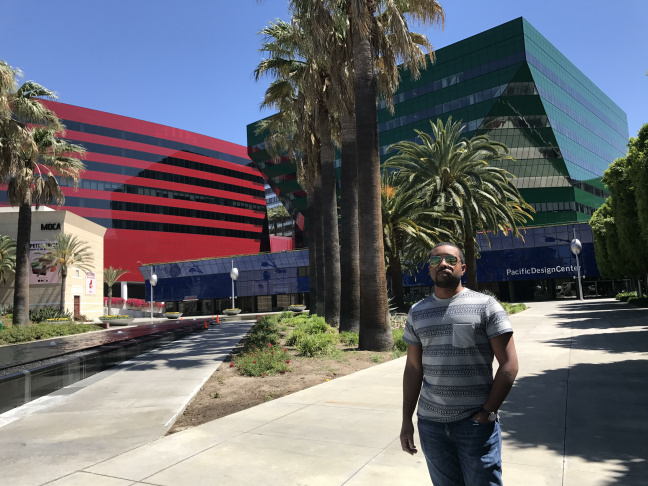 Jason Morris, newly licensed architect stands in front of the Pacific Design Center. Normal Sklarek, the first African-American woman to be licensed as an architect, was key to building the blue portion.