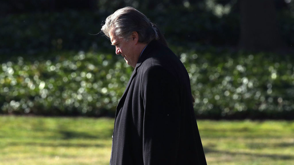 White House chief strategist Steve Bannon walks behind President Trump toward Marine One before departing from the White House in February.