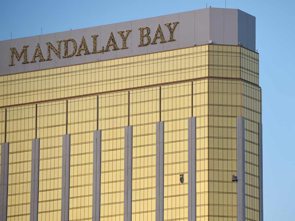 Broken windows are seen on the 32nd floor of the Mandalay Bay Resort and Casino after a lone gunman opened fired on the Route 91 Harvest country music festival on Oct. 2, 2017 in Las Vegas, Nevada. The gunman, identified as Stephen Paddock, 64, of Mesquite, Nevada, opened fire from the Mandalay Bay Resort and Casino on the music festival.