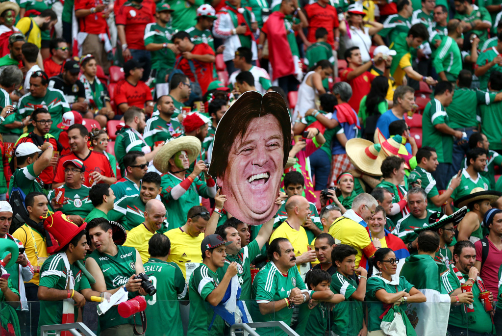 Mexico fans hold up a cutout of head coach Miguel Herrera during the 2014 FIFA World Cup Brazil Group A match between Croatia and Mexico at Arena Pernambuco on June 23, 2014 in Recife, Brazil.