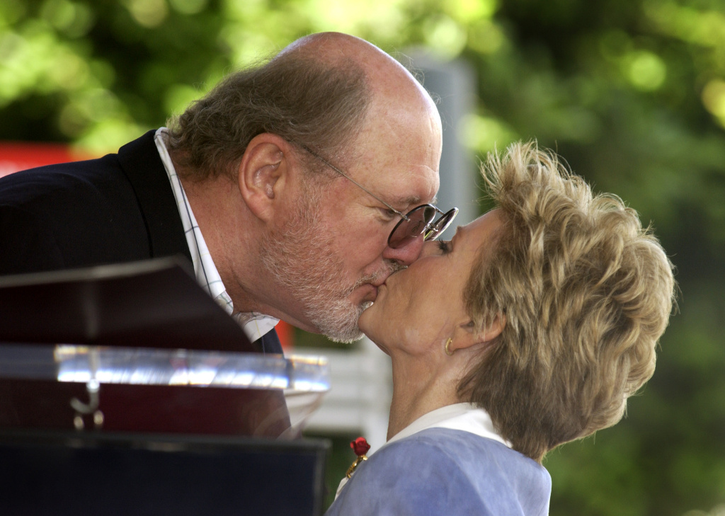 Actor David Ogden Stiers kisses actress Patty Duke at the ceremony honoring Duke with a star on the Hollywood Walk of Fame August 17, 2004 in Hollywood, California.