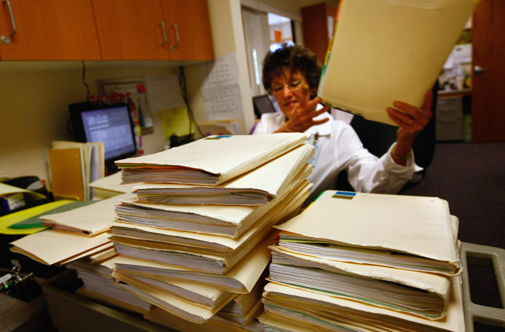 Clinic office assistant Joan Vest searches for a patient's mssplaced medical file at the Spanish Peaks Family Clinic on August 5, 2009 in Walsenburg, Colorado. The Spanish Peaks Regional Health Center, which treats rural residents from throughout southern Colorado, plans to move to an electronic health records system before the end of 2010. Administrators say they expect the costs of upgrading the system will eventually be recovered through federal funds, as part of the overhaul of the nation's healthcare system.